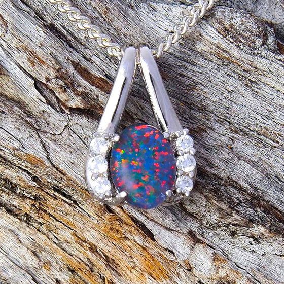 Pretty sterling silver necklace pendant claw set with a colourful oval floral patterned triplet opal and six cubic zirconias