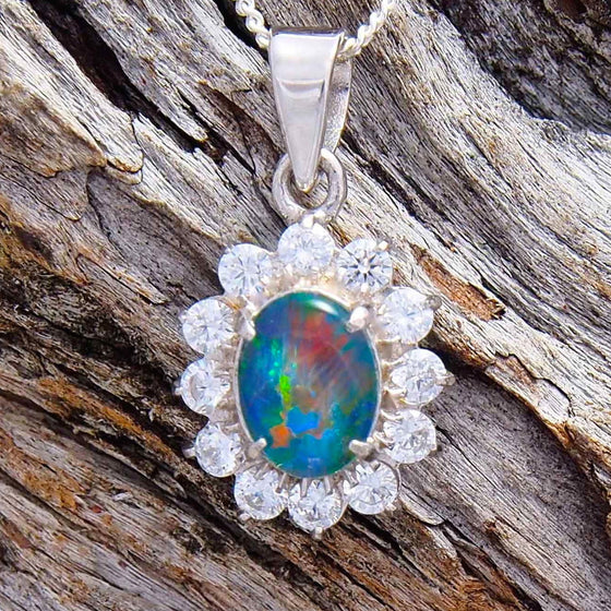 Beautiful sterling silver princess design necklace pendant claw set with a colourful oval triplet opal and twelve cubic zirconias