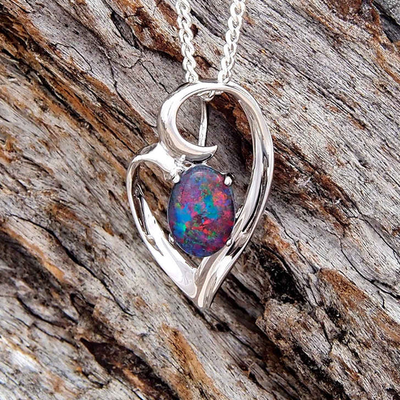 Stylish sterling silver heart style necklace pendant claw set with a blue, green and red oval triplet opal.