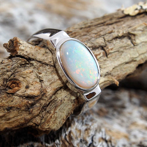 Simple sterling silver ring bezel set with a beautiful multi-colour oval South Australian solid white opal.