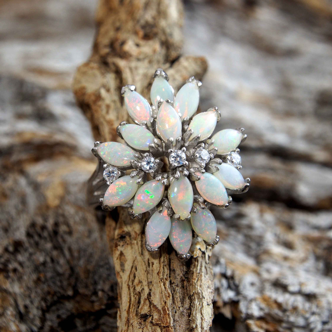 Stunning sterling silver dress ring claw set with sixteen marquise shape multi-colour South Australian solid crystal opal.