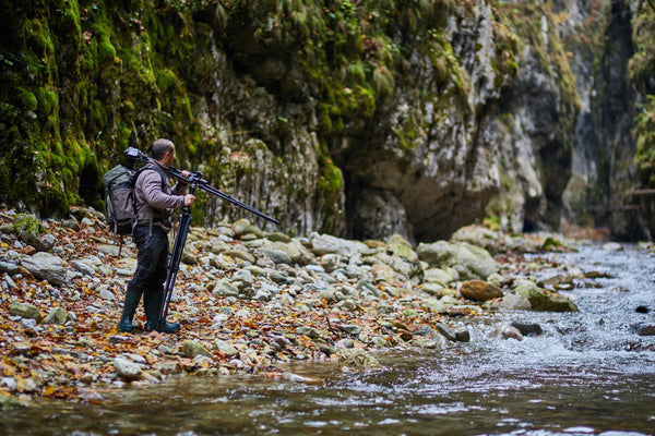 Nature photographer crossing the river