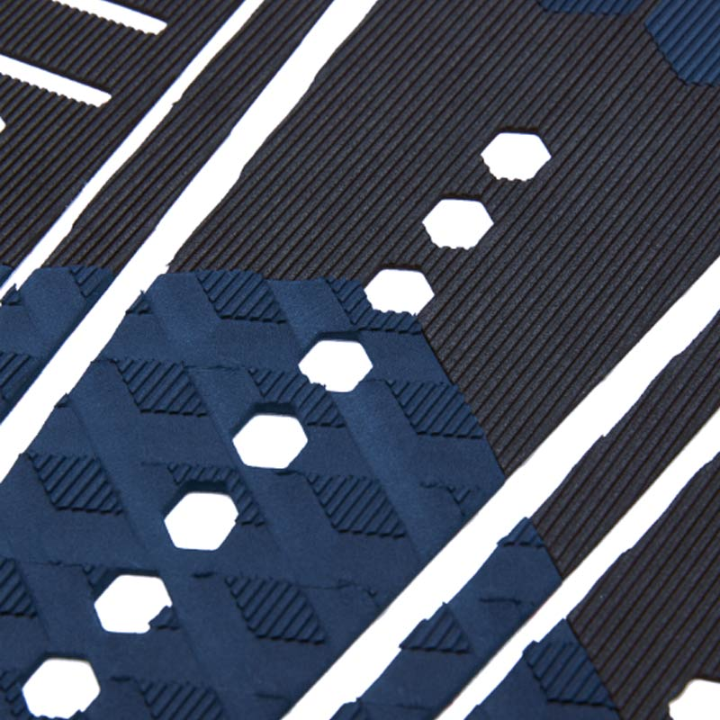 Shop Channel Islands 50/50 Flat Tail Pad - Black/Indigo Vertical Groove Close Up | Benny's Boardroom