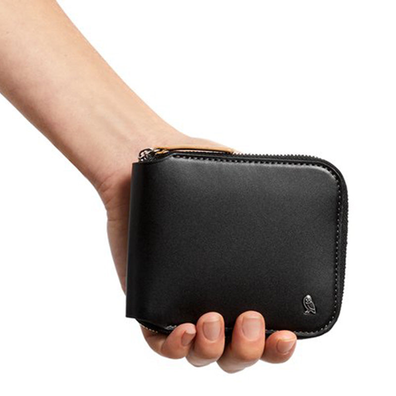 Shop Online Bellroy Zip Wallet - Black In Hand | Benny's Boardroom