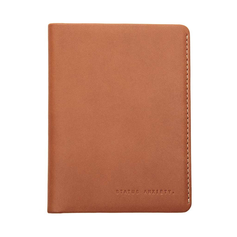 Shop Status Anxiety Conquest Leather Passport Wallet - Camel | Benny's Boardroom