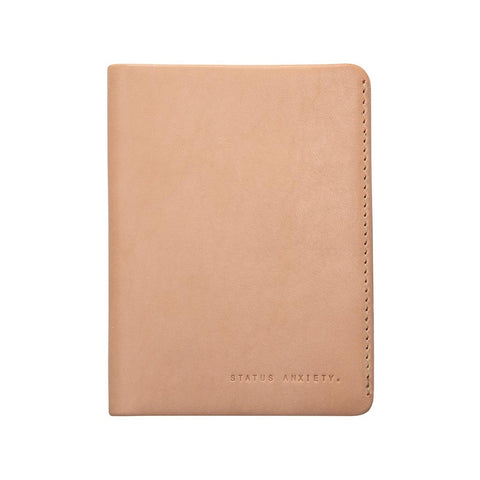Shop Status Anxiety Conquest Leather Passport Wallet - Tan | Benny's Boardroom