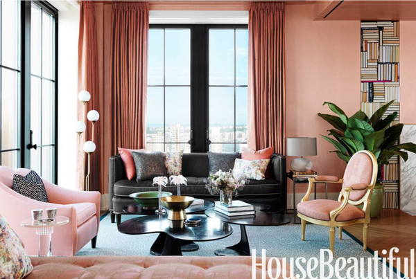 Janery Blush pink decor paired with accents of black in the living room