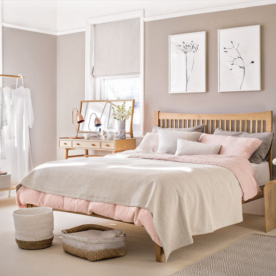 Janery Decorating with blush paired with neutrals, beige walls, natural wood bed