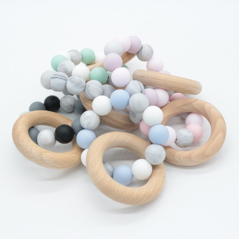 Wooden teether in different colors
