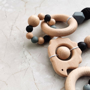 wooden toy with silicone beads