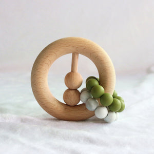 wood teether with green beads