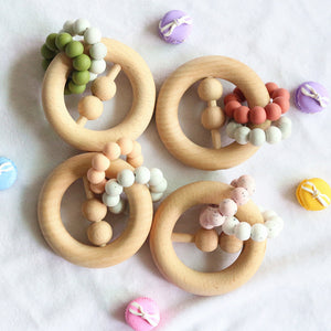 Ring wooden rattles in different colors