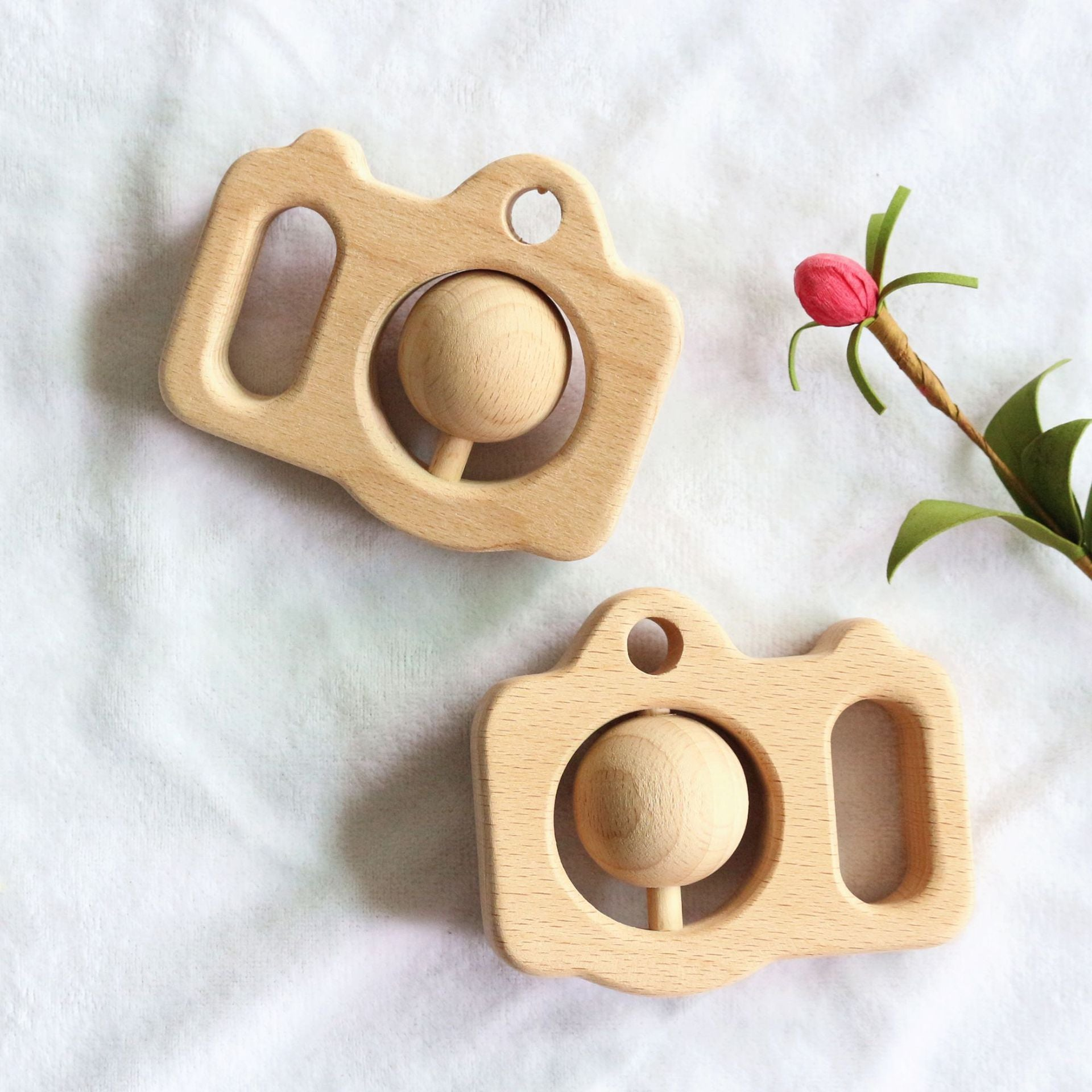 wooden teether in the shape of camera