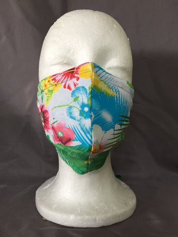 Tropical aloha patterned fabric mask with palm fronds and flowers