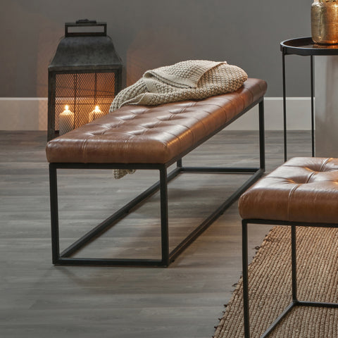 Brown leather bench and matching foot stool