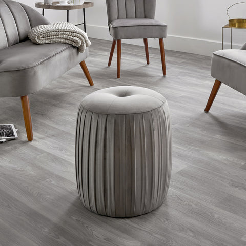 Grey velvet pouffe and matching grey chairs