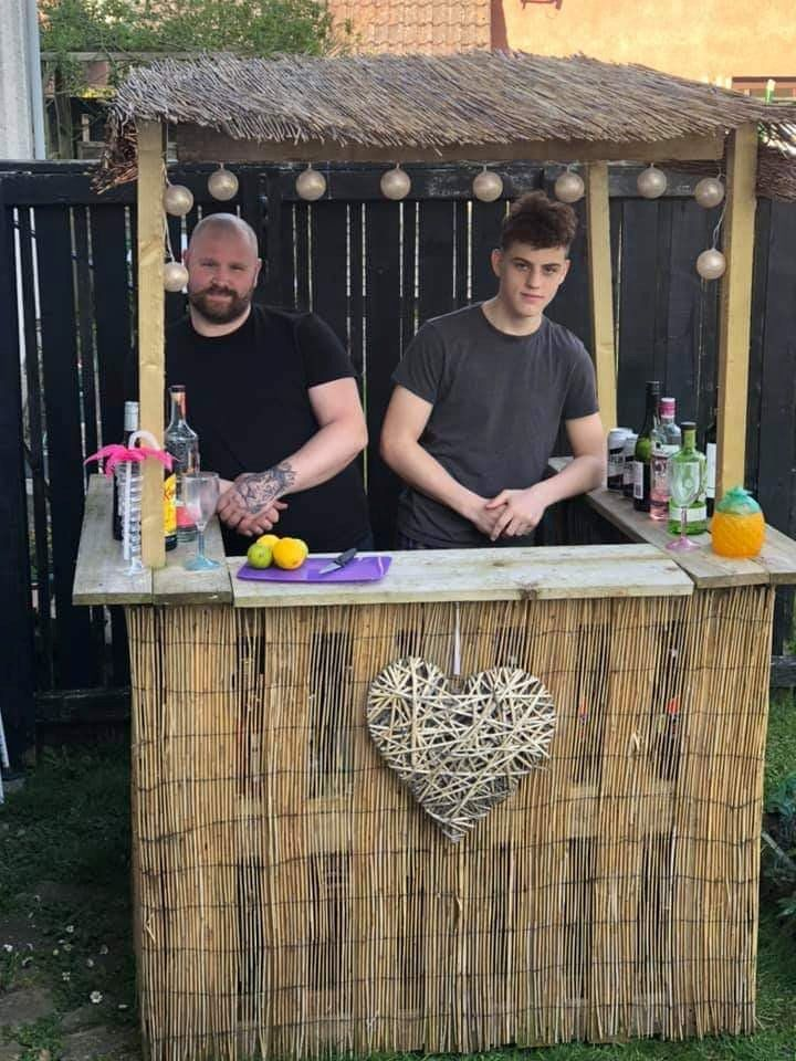 Family build their own tiki bar in the garden after the coronavirus lockdown ruined their holiday plans