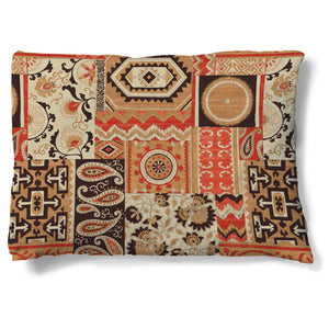 "Southwest Story 30"" x 40"" Fleece Dog Bed features a patchwork design mixing patterns such as paisley and geometric prints set in a vibrant orange and rich browns."
