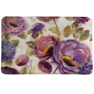 Precious Purples and Blues memory foam rug features a serene floral design with lively roses and hydrangeas in deep violet and blue hues on a textured, beige background.