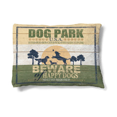"Dog Park 30"" x 40"" Fleece Dog Bed features dogs in silhouette playing along a field at sunset."