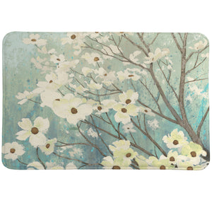 Dogwood Blossom Memory Foam Rug features white dogwoods blossoming from branches set behind a vibrant sky.