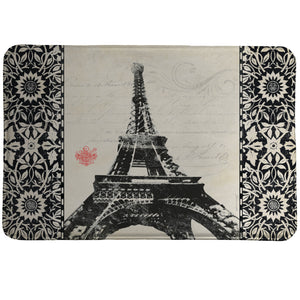 Eiffel Tower Memory Foam Rug features a bold black Eiffel Tower with handwritten script and design accents.