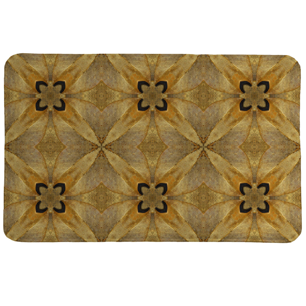 Golden Magnolia Memory Foam Rug features an abstract pattern inspired by magnolia flowers, leave, and cones.