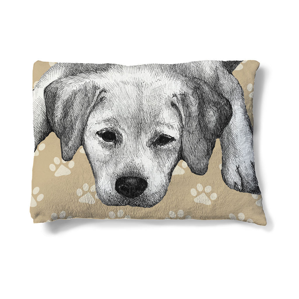 "Yellow Lab Sketch 30"" x 40"" Fleece Dog Bed features a yellow lab resting peacefully before a paw-print backdrop."