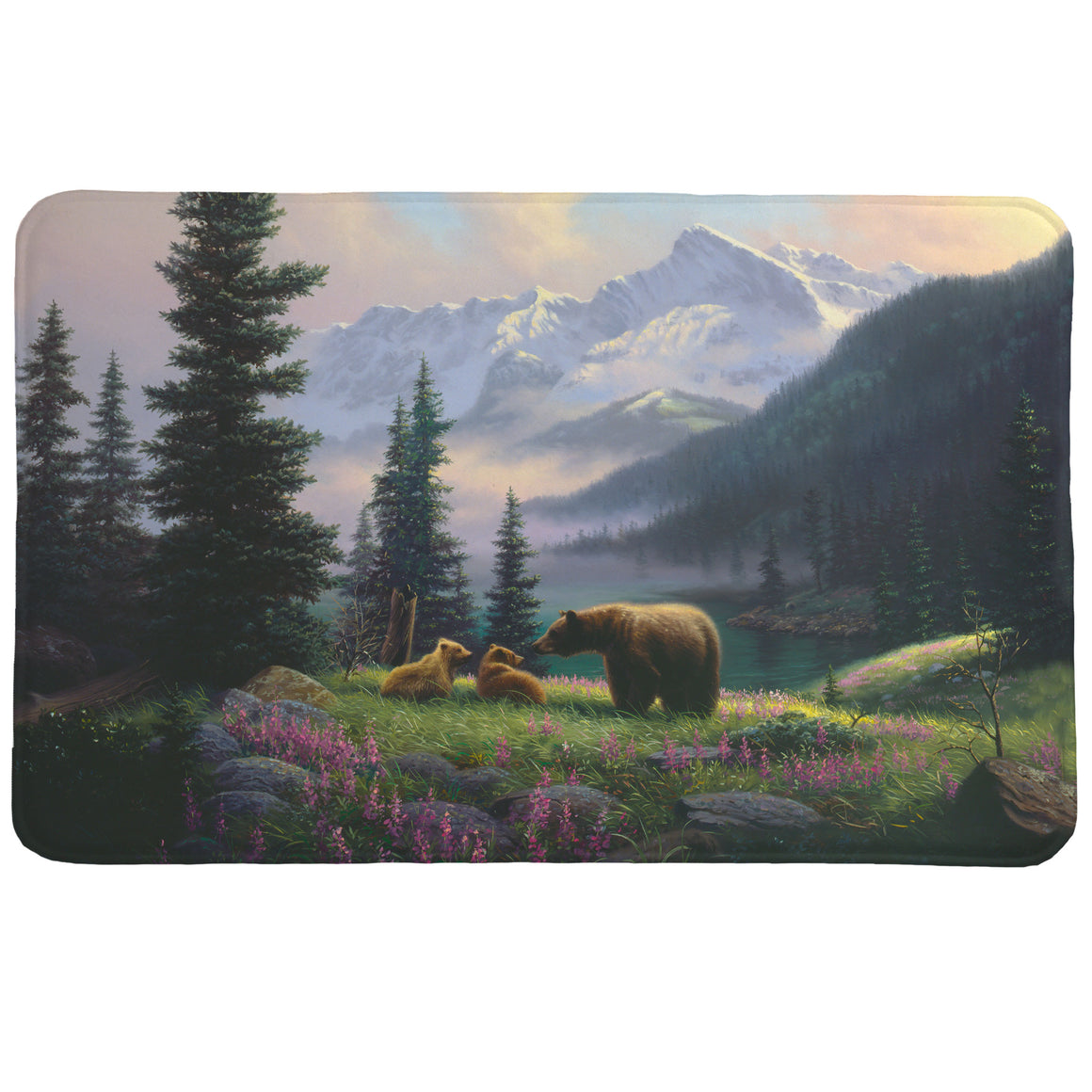 Mountain Bear with Cubs Memory Foam Rug has a majestic and serene mountain landscape that features a brown bear and her two cubs in a field of purple wildflowers.