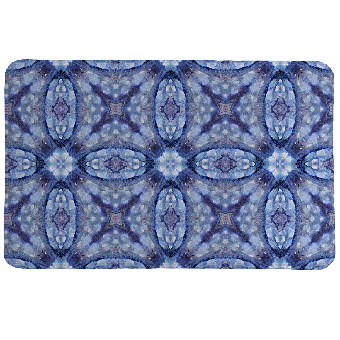 Mystery Blue Memory Foam Rug has an abstract, kaleidoscope-like pattern dominated by various shades of blue.
