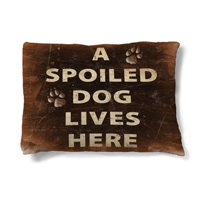 "Spoiled Dog 30"" x 40"" Fleece Dog Bed features the heading amongst paw prints and is set on a rich, brown background."