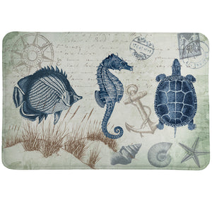 Seaside Postcard Memory Foam Rug is a vintage coastal-themed accent rug featuring navy and and soft green sea creatures and shells.