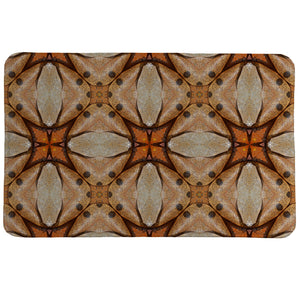 Terra Cotta Magnolia Leaves Memory Foam Rug features an abstract pattern inspired by dried leaves and their rich colors.