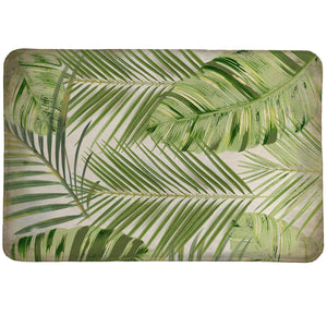 Tropic Palms Memory Foam Rug features tropical leaves set in bright greens.