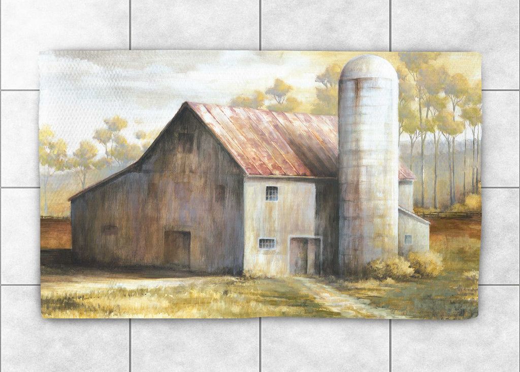 "Laural Home's ""Autumn Barn Accent Rug"" portrays an artist painting of a barn in an autumnal landscape. This rustic design is the perfect addition for a vintage country space!"