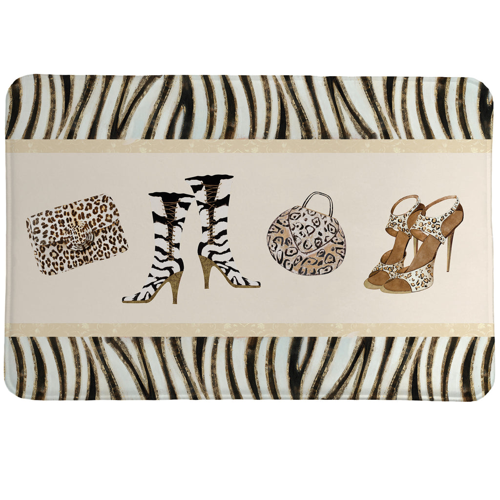 Wild for Fashion Memory Foam Rug showcases stylish shoes and purses set on a zebra background.