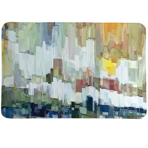 Glacier Bay Memory Foam Rug portrays a modern abstract image of crystal rising out of the cold sea.