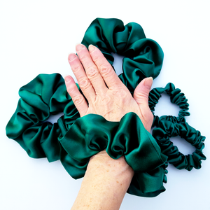 green silk hair accessory scrunchie for pony tail bun or wrist wear