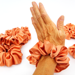 Load image into Gallery viewer, orange silk scrunchie hair tie elastic hair tie
