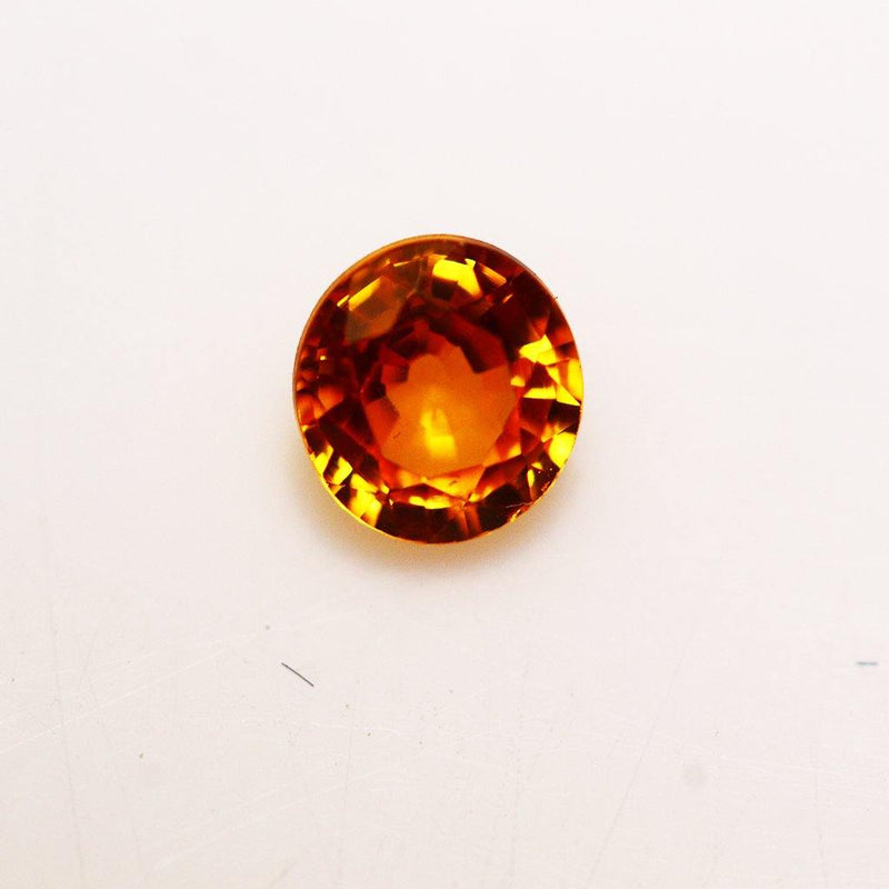 0.63ct Natural Orange Yellow Sapphire.