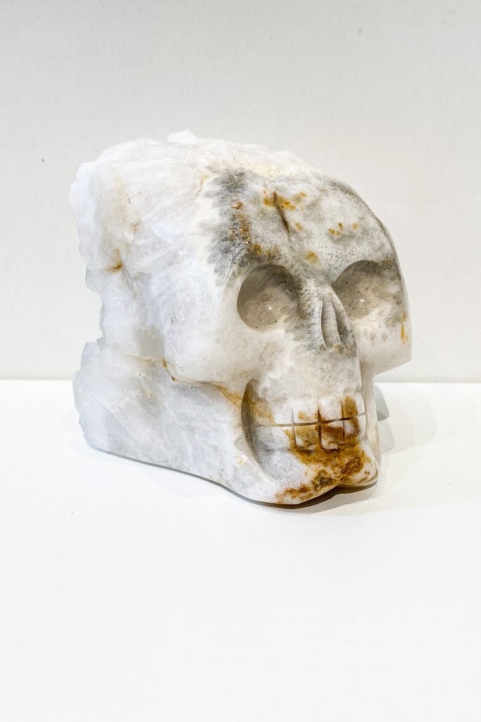 Clear Quartz Crystal Skull with cluster