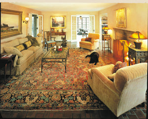 An antique rug in a traditional room