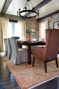 For a dining room, choose a rug that has enough room for the chairs.