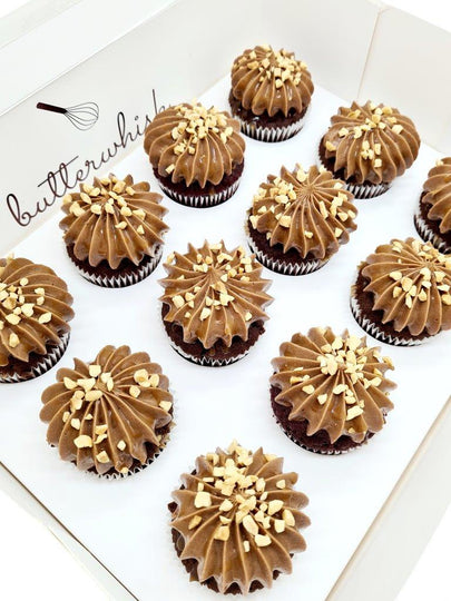 Chocolate buttercream drizzled with caramel and topped with peanuts on vanilla or chocolate cupcakes