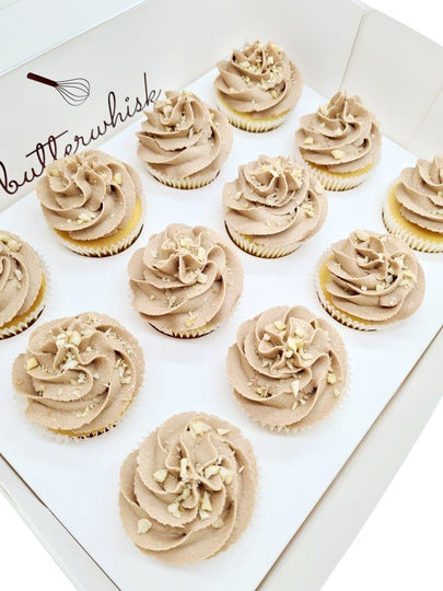 Nutella buttercream topped with hazelnuts on vanilla or chocolate cupcakes
