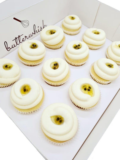 Passionfruit and vanilla buttercream topped with passionfruit pulp on vanilla cupcakes