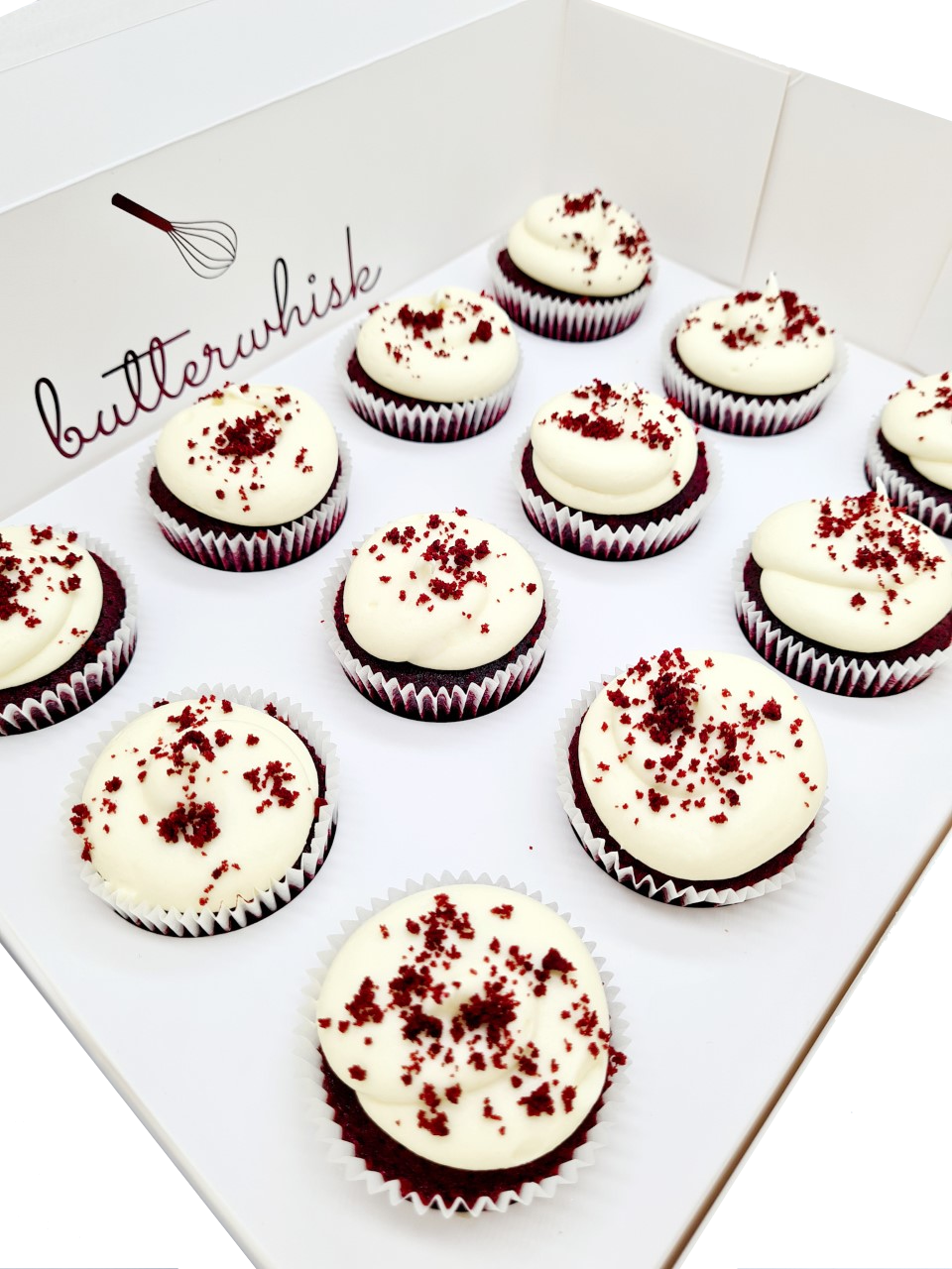 Cream cheese frosting on red velvet cupcakes