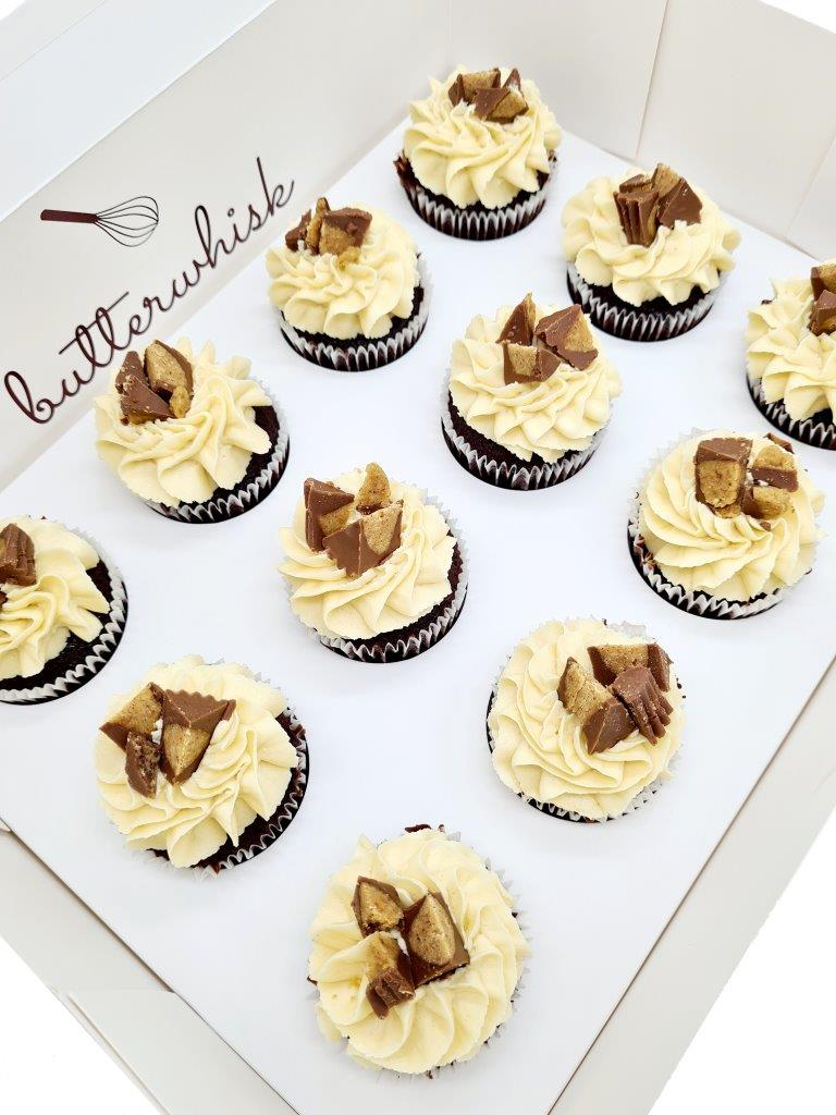 Peanut butter buttercream topper with Reese's Peanut Butter Cups on vanilla or chocolate cupcakes
