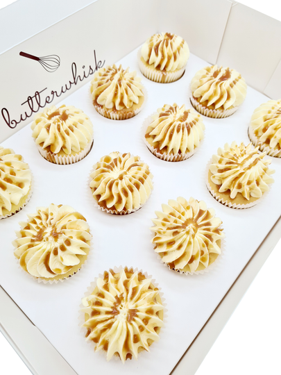 Salted caramel buttercream drizzled with salted caramel on vanilla or chocolate cupcakes