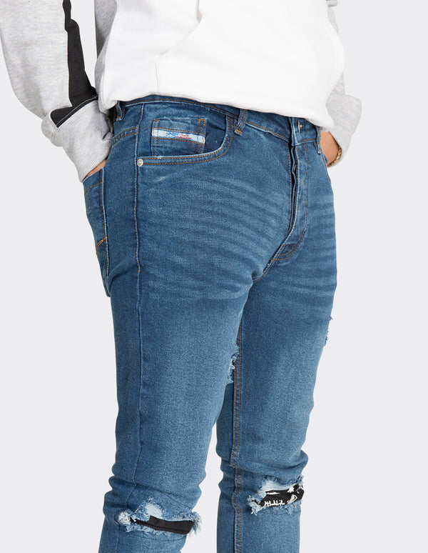 Blue skinny fit knee patch jeans